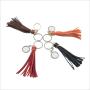 Set 4 sleutelhangers met kwastje in 4 kleuren